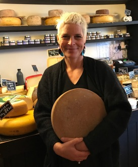Maja Beaujouan holding a wheel of her cheese