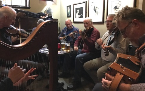 Drop-in musicians in a tiny pub playing traditional tunes